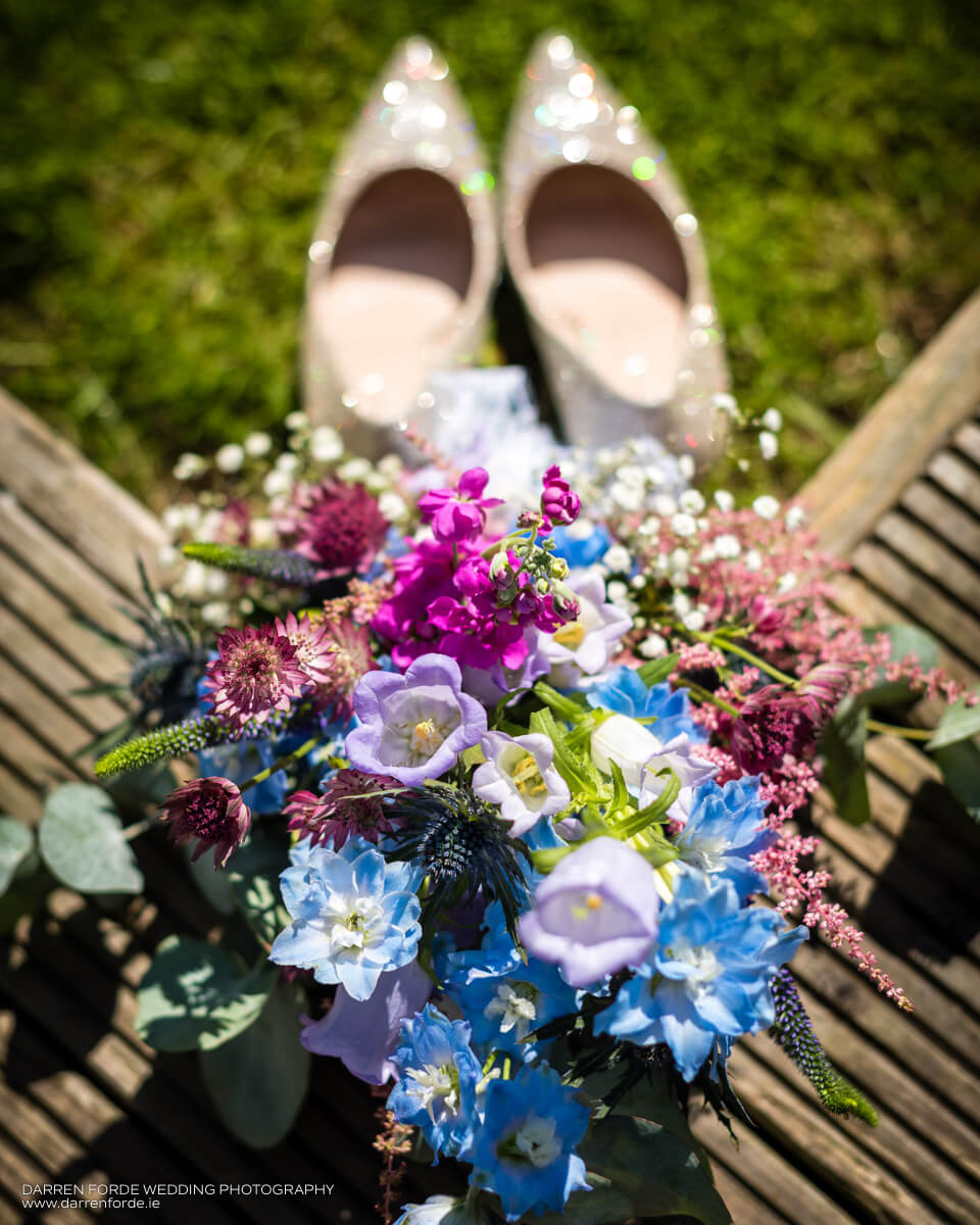 Jillian's wedding bouquet and shoes. Image by Darren Forde