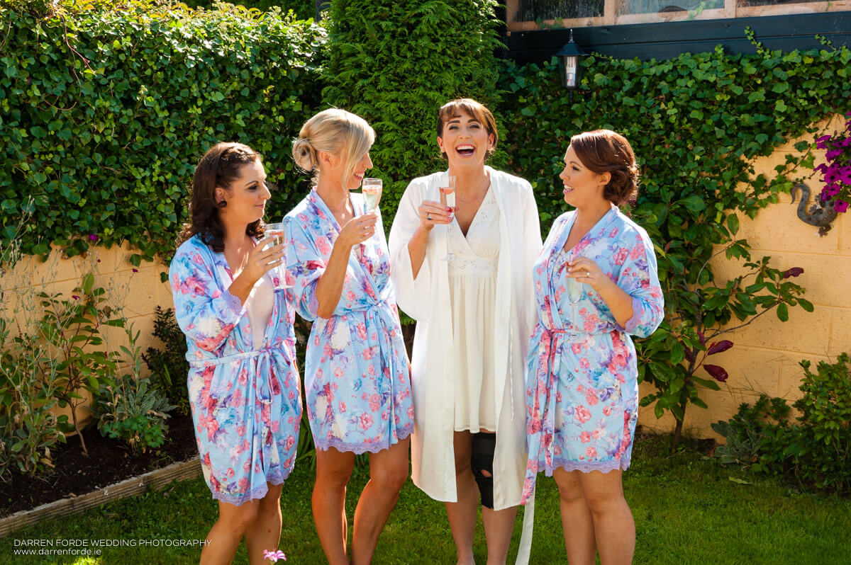 Matching robes for the bridal party at the morning of Adriana and Jillian's wedding. Image by Darren Forde - www.darrenforde.ie