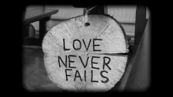 Love Never Fails - Wood Sign